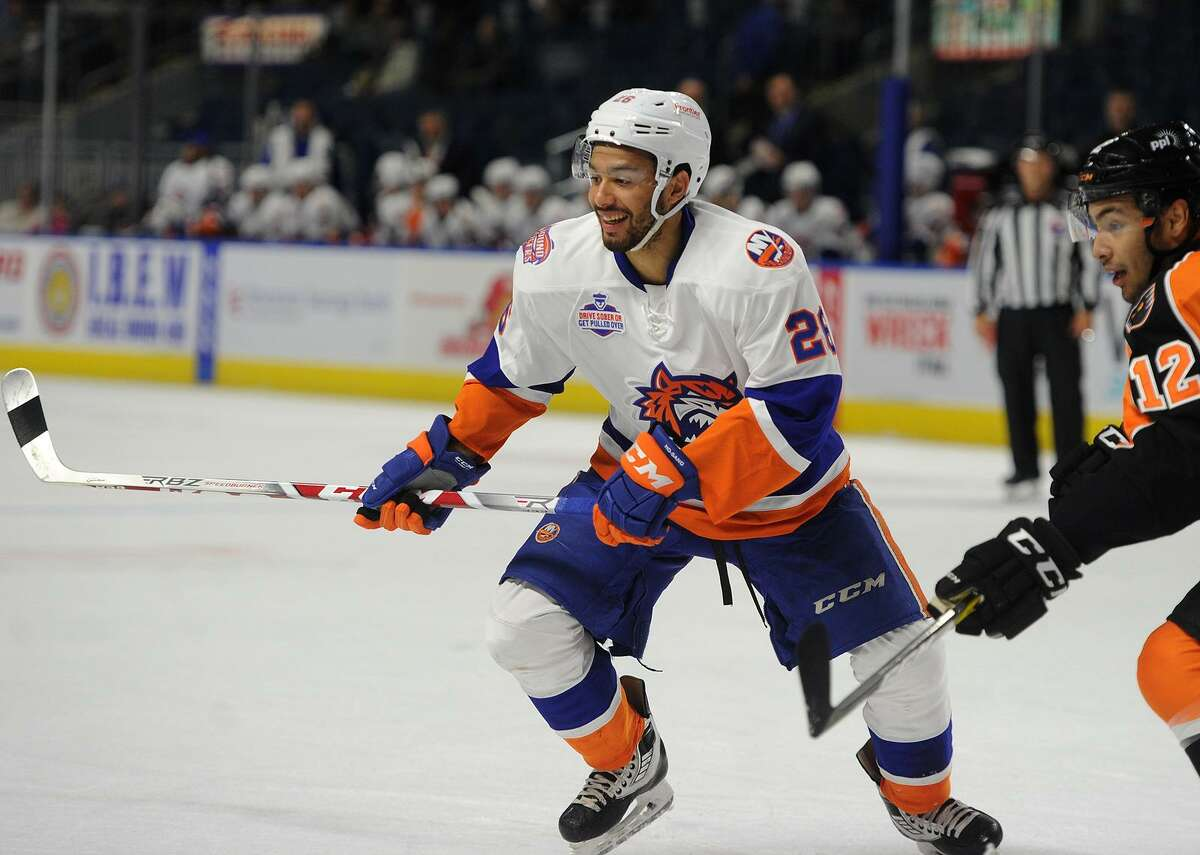 Bridgeport Sound Tiger Josh Ho-Sang smiles while being defended by Lehigh Valley's Tyrell Goulbourne during their AHL hockey game at the Webster Bank Arena in Bridgeport, Conn. on Wednesday, November 8, 2017.