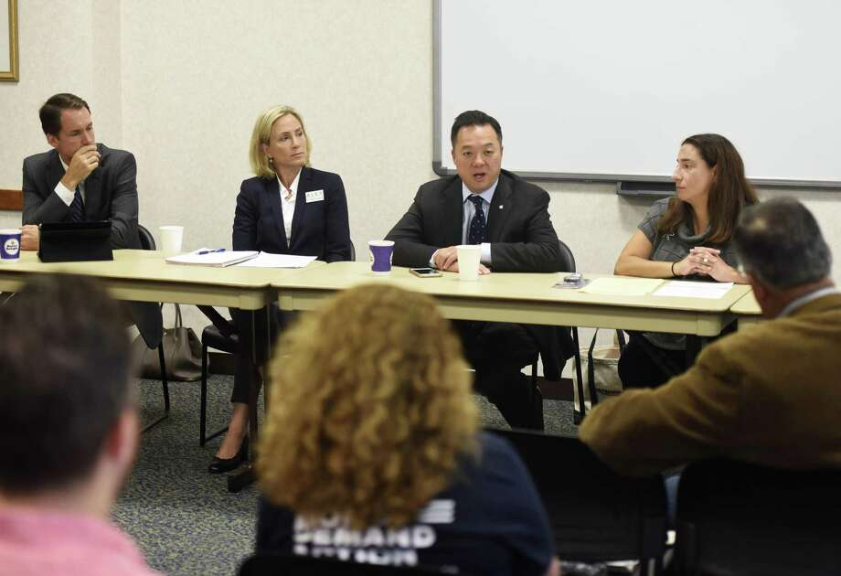 State Rep. William Tong, D-Stamford, speaks beside U.S. Rep. Jim Himes, D-Greenwich, left, Democratic candidate for State Senate Alexandra Bergstein, second from left, and Democratic candidate for State Representative Laura Kostin, during a roundtable discussion on guns at Town Hall in Greenwich, Conn. Thursday, Oct. 4, 2018. U.S. Rep. Jim Himes, D-Greenwich, and State Rep. William Tong, D-Stamford, spoke about gun laws and legislation with Democratic candidates Alexandra Bergstein, running for State Senate, and Laura Kostin, running for State Representative. Photo: Tyler Sizemore / Hearst Connecticut Media / Greenwich Time
