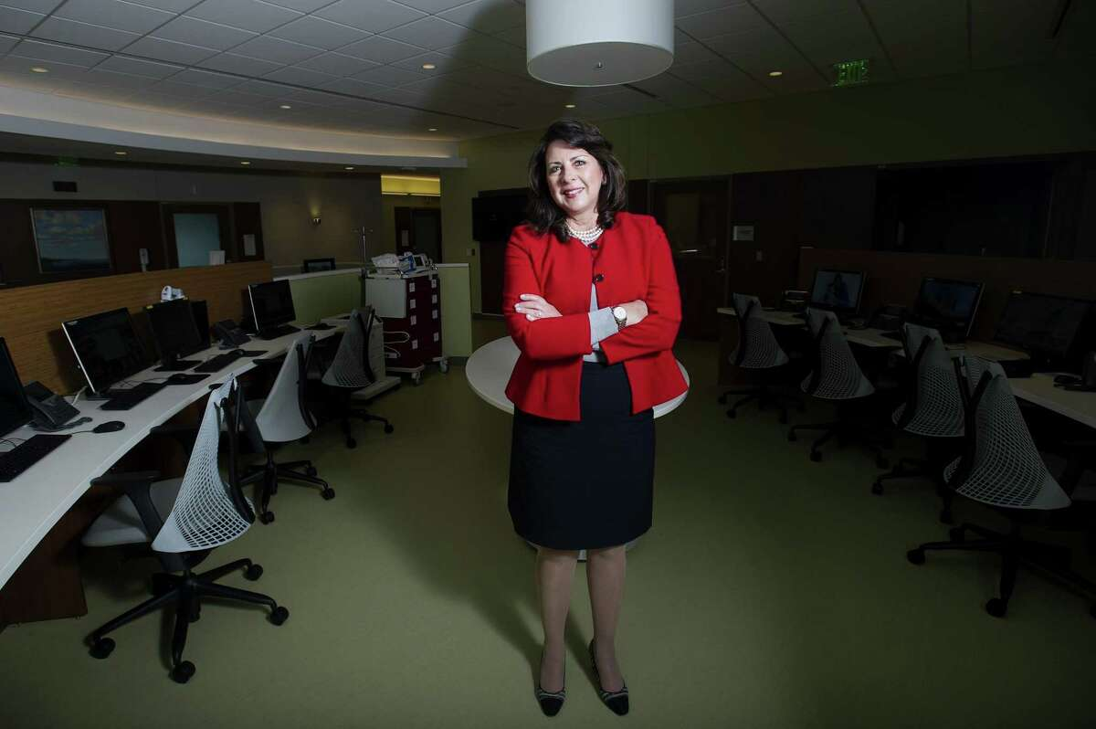 New Stamford Hospital CEO and president Kathleen Silard poses for a photo by a nurses station inside Stamford Hospital in Stamford, Conn. on Thursday, Oct. 4, 2018. Silard was previously the hospital's chief operating officer before replacing former CEO Brian Grissler, who retired on Sunday.