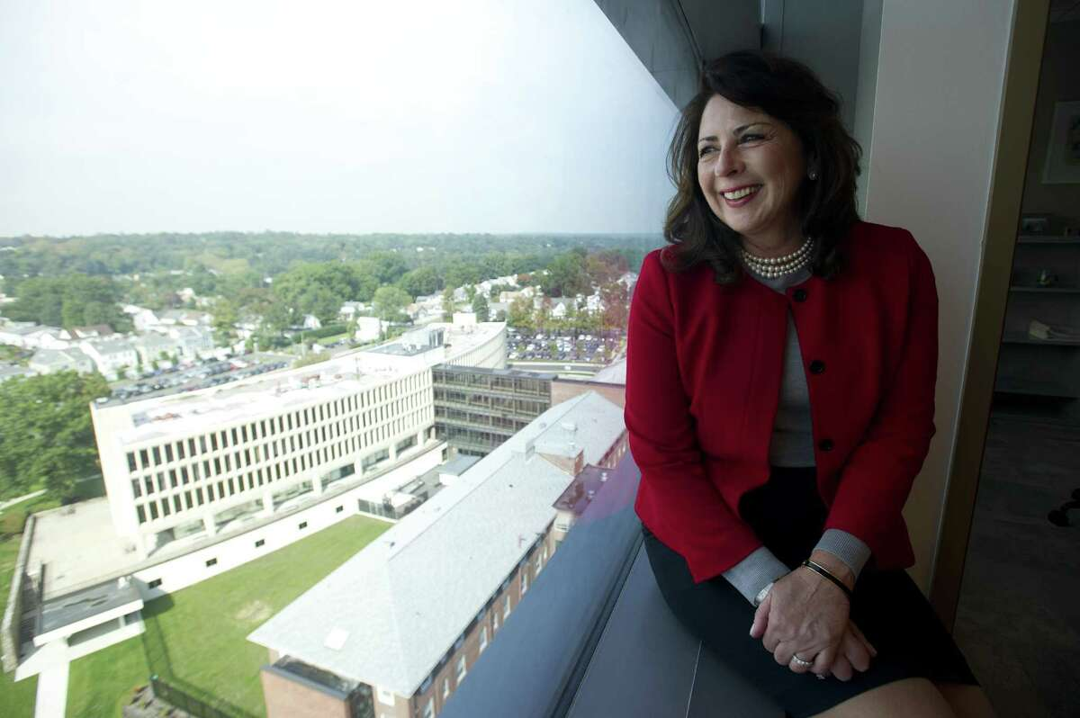 New Stamford Hospital CEO and president Kathleen Silard looks out a window of Stamford Hospital overlooking the former hospital in Stamford, Conn. on Thursday, Oct. 4, 2018. Silard was previously the hospital's chief operating officer before replacing former CEO Brian Grissler, who retired on Sunday.