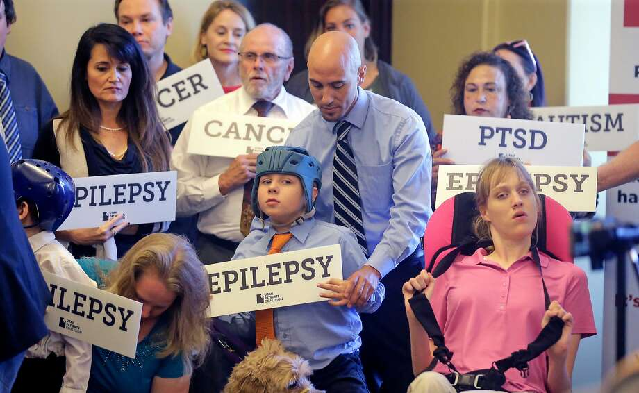 Patients, caregivers and supporters of legalizing medical marijuana displayed signs at a news conference last year in Salt Lake City. Medical use now is legal in more than 30 states. Photo: Rick Bowmer / Associated Press 2017