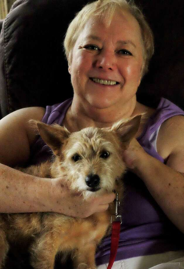Sonja Edgington of Katy willtravel to Washington, D.C., as part of Honor Flight Houston's first All Vietnam Veteran Honor Flight on Oct 19-20. Her buddy in the photo is Norman, who was adopted through Paws for Heroes. Photo: Courtesy Sonja Edgington / Courtesy Sonja Edgington