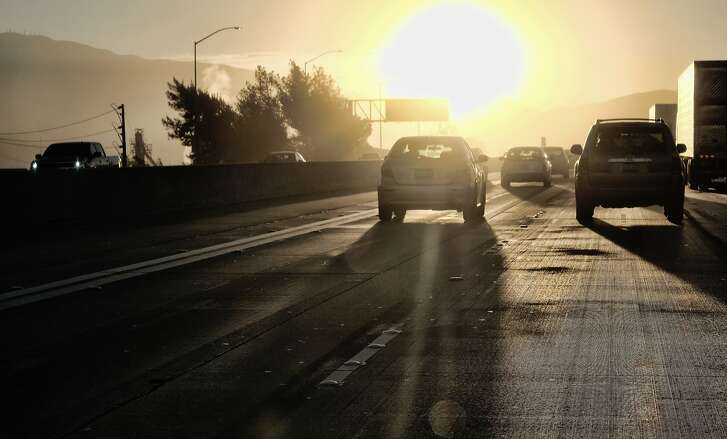 ADVANCE FOR RELEASE SATURDAY, OCT. 6, 2018, AND THEREAFTER - In this Aug. 31, 2018, 2018 photo morning commuters drive into downtown Los Angeles as the sun rises along Interstate 5. It's clockwork: Every fall and spring, Californians and the rest of the nation switch to daylight saving or standard time, often with gripes about losing an hour of sleep, the sun setting earlier in the day or the chore of changing analogue clocks. This November, California voters will get to decide if it's time for a change. If voters approve Proposition 7 on Nov. 6, that would pave the way for year-round daylight saving time in the state. (AP Photo/Richard Vogel)