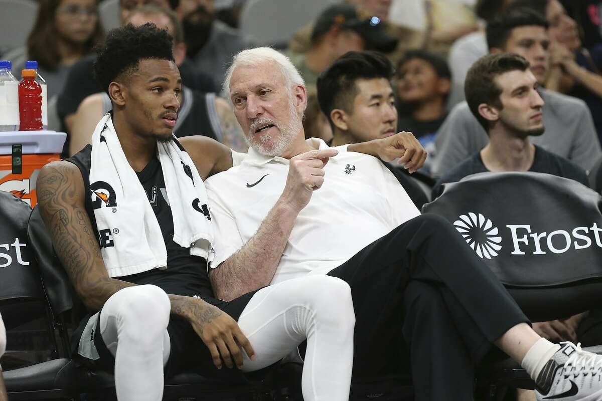 San Antonio Spurs' head coach Gregg Popovich talks with Dejounte Murray during the Silver & Black Open Scrimmage at the AT&T Center, Wednesday, Oct. 3, 2018.