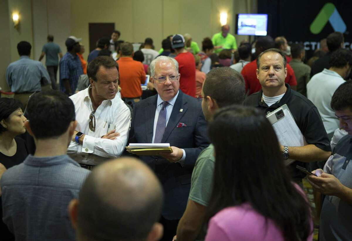 Property trustees hold mini auctions of their own among the larger auctions during the monthly foreclosure auction hosted by Harris County at the Bayou City Events Center, Tuesday, Oct. 2, 2018 in Houston.