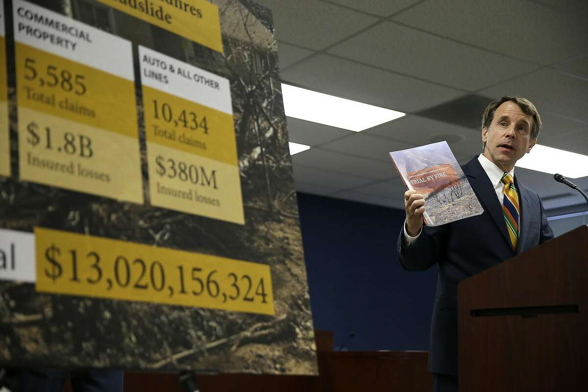 California Insurance Commissioner Dave Jones holds up a report during a news conference about the costs of recent wildfires Thursday, Sept. 6, 2018, in San Francisco. Jones released the first data on the total insurance claims reported for residential and commercial losses following the Carr and Mendocino Complex wildfires. Commissioner Jones also released updated data for the 2017 California wildfires and 2018 mudslides. The number at left is the grand total of insured losses from the 2017 wildfires and Montecito mudslide. (AP Photo/Eric Risberg)