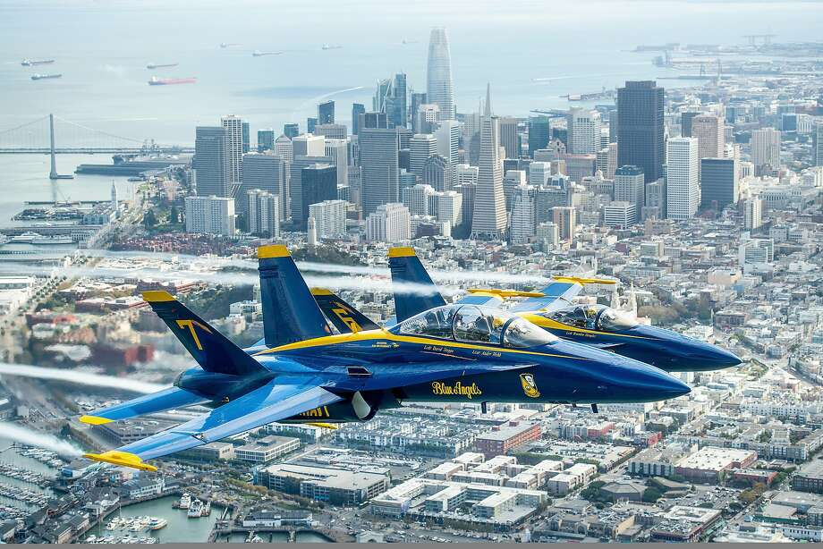 In advance of Fleet Week performances, the U.S. Navy Blue Angels and Team Oracle aerobatics pilot Sean D. Tucker fly over the San Francisco Bay during a photo flight on Thursday, Oct. 4, 2018. (AP Photo/Noah Berger) Photo: Noah Berger, AP