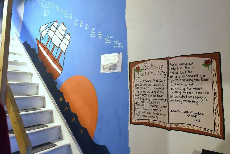 Murals cover the walls along the staircase of the Stephen and Harriet Myers Residence which is part of the Underground Railroad Heritage Trail on Livingston Ave. Thursday, Oct. 4, 2018 in Albany, N.Y. High school students applied for the chance to paint murals on the museum for the exhibit Seeking Sanctuary. (Lori Van Buren/Times Union)