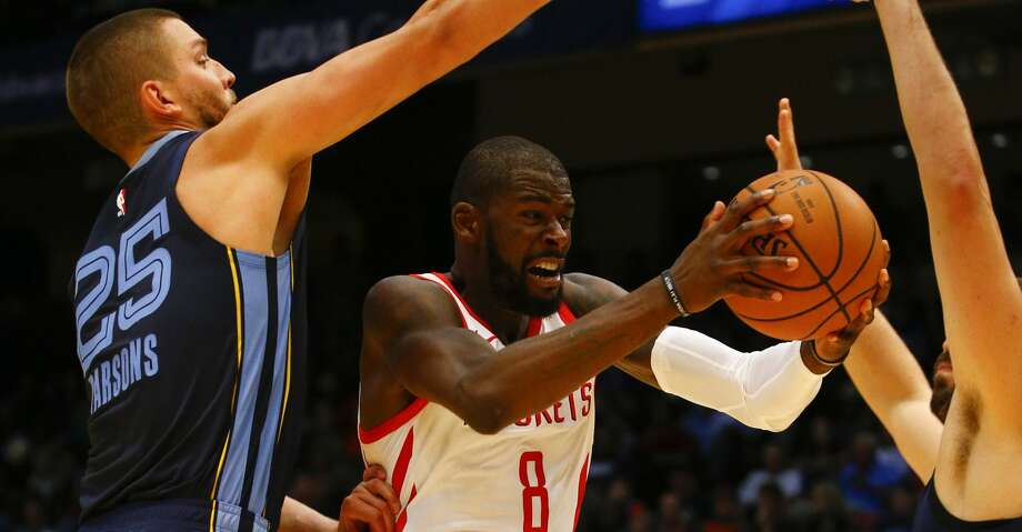 Houston forward James Ennis III (8) is fouled by Memphis forward Chandler Parsons (25) as he goes up for a shot during the second half of a preseason NBA basketball game, Tuesday, Oct. 2, 2018, in Birmingham, Ala. Houston Rockets won 131-115. (AP Photo/Butch Dill) Photo: Butch Dill/Associated Press