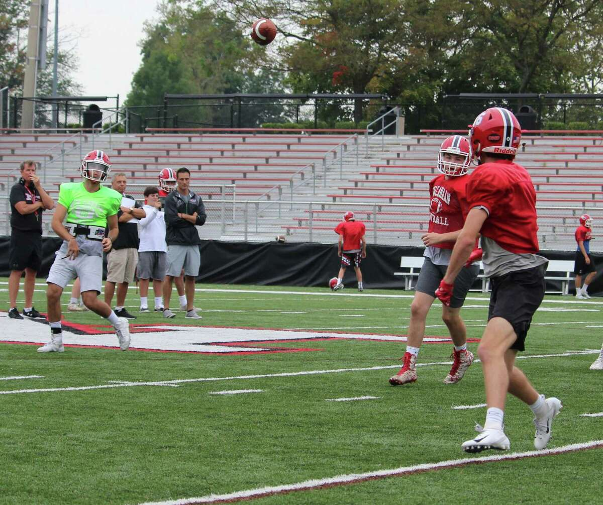 Sophomore running back Christian Sweeney catches a pass from quarterback Drew Pyne during a New Canaan practice on Thursday, Oct. 4, 2018 at New Canaan High School in New Canaan, Conn.