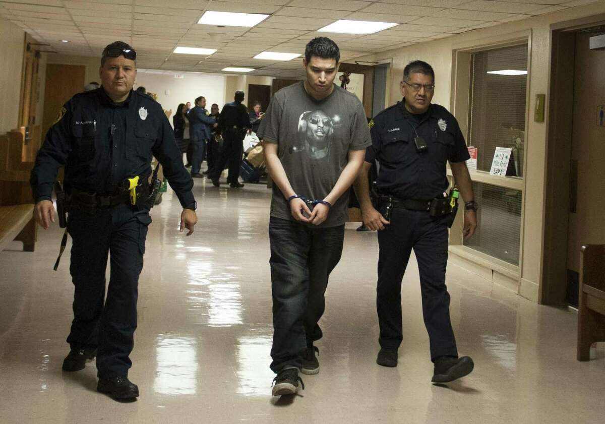 Isaac Andrew Cardenas is lead away in handcuffs Thursday after being found guilty of super aggravated sexual assault of a child in a horrific attack on a 21-month-old girl whom the mother told authorities had been attacked by dogs but actually had been attacked and stabbed in the genitals.