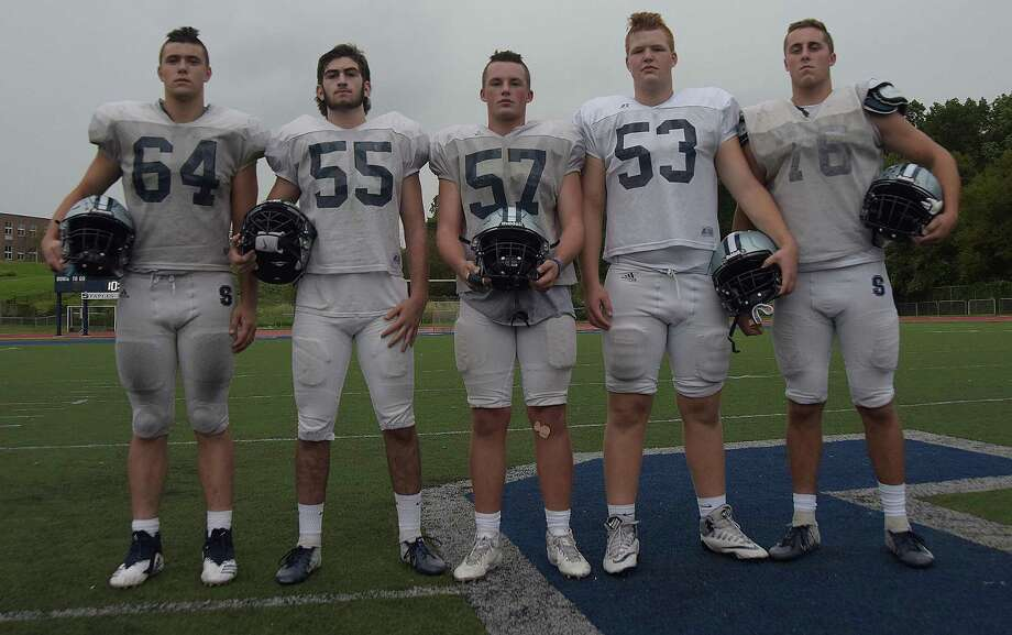 The Staples High offensive line, from left, junior Jake Rizzy, senior Dean Gendel, junior Ben Howard, sophomore Sam Millberg and senior captain Matt Almasi, is a big reason behind the Wreckers 4-0 start this season. Photo: John Nash / Hearst Connecticut Media