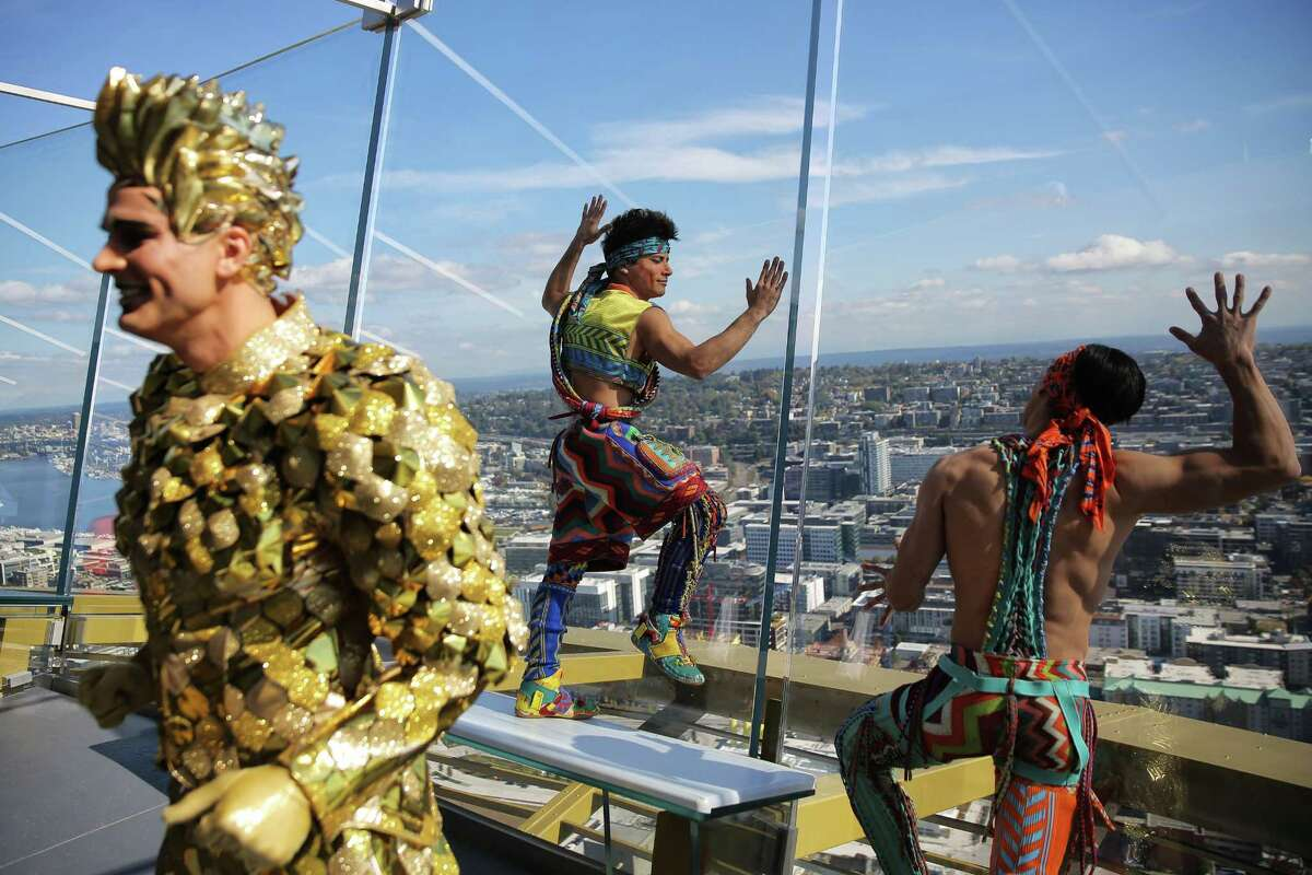 Performers in Cirque du Soleil's VOLTA took over the Space Needle, Thursday, doing acrobatics and poses on the roof, antenna, observation deck and between the rotating glass floors, Oct. 4, 2018. VOLTA will be in Seattle for one more month before moving on to the next city.