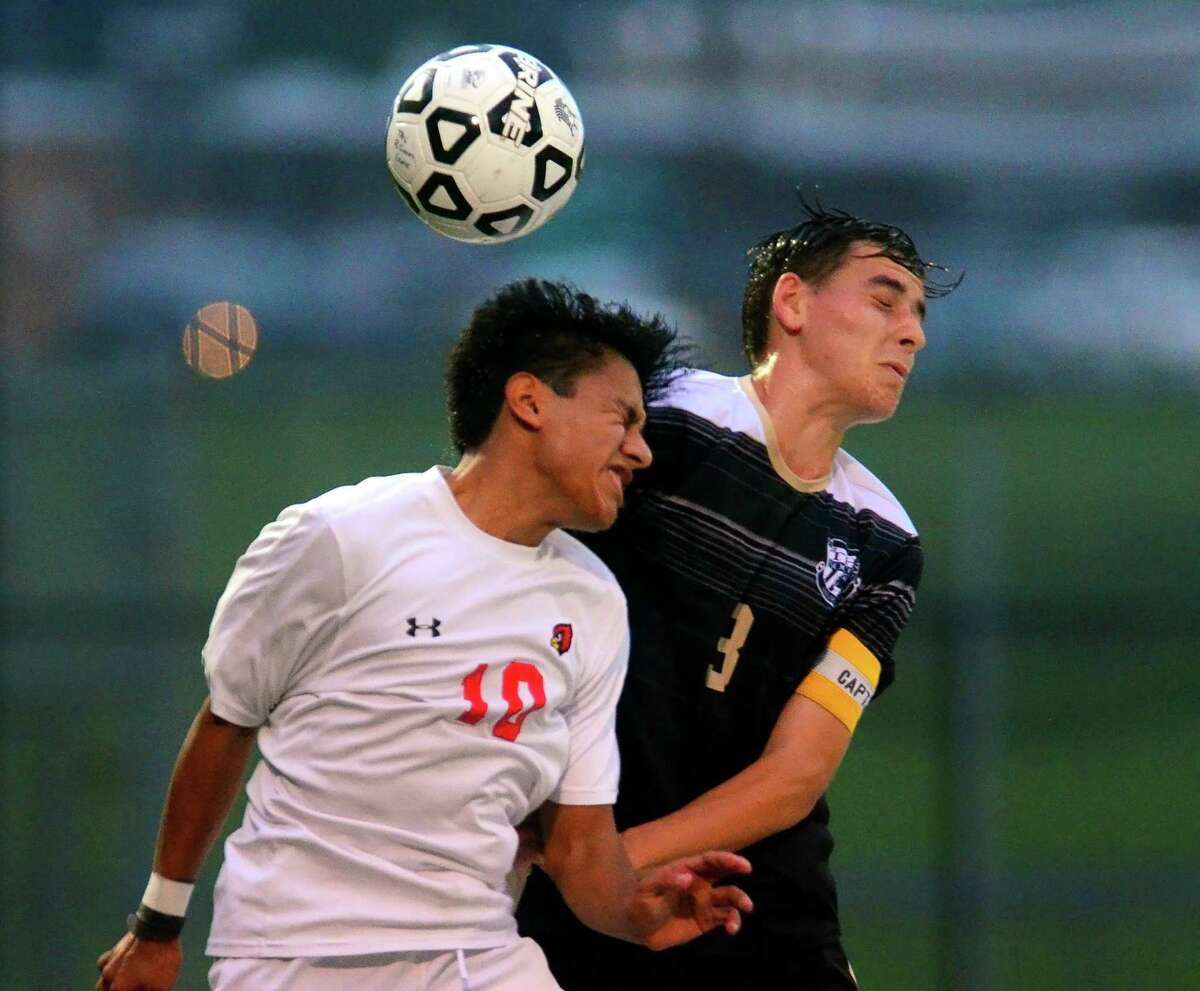 Greenwich's Christopher Cruz (10) and Trumbull's Bryant Recker head the ball during boys soccer action on Thursday in Trumbull.
