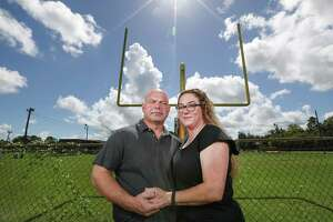 Troy and Donna Yarbrough, parents of C.Y., a teen injured from helmet-to-helmet contact at a scrimmage for the Santa Fe High School Indians in 2016, is shown here on Wednesday, Oct. 3, 2018, in Santa Fe. The Yarbroughs have filed a federal lawsuit against the Santa Fe school district, accusing officials of failing to protect the teen from injury.