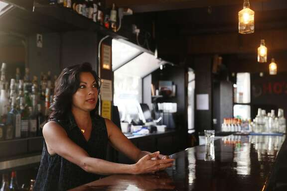 Masaye Waugh, co-owner Bootleg Bar and Kitchen, stands behind the bar at  Bootleg Bar and Kitchen on Thursday, October 4, 2018 in San Francisco, Calif.