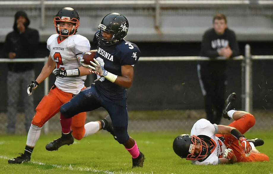 Ansonia's Shykeem Harmon avoids a tackle attempt by Watertown's Rich Ojeda Thursday at Jarvis Stadium in Ansonia. Photo: Catherine Avalone / Hearst Connecticut Media / New Haven Register