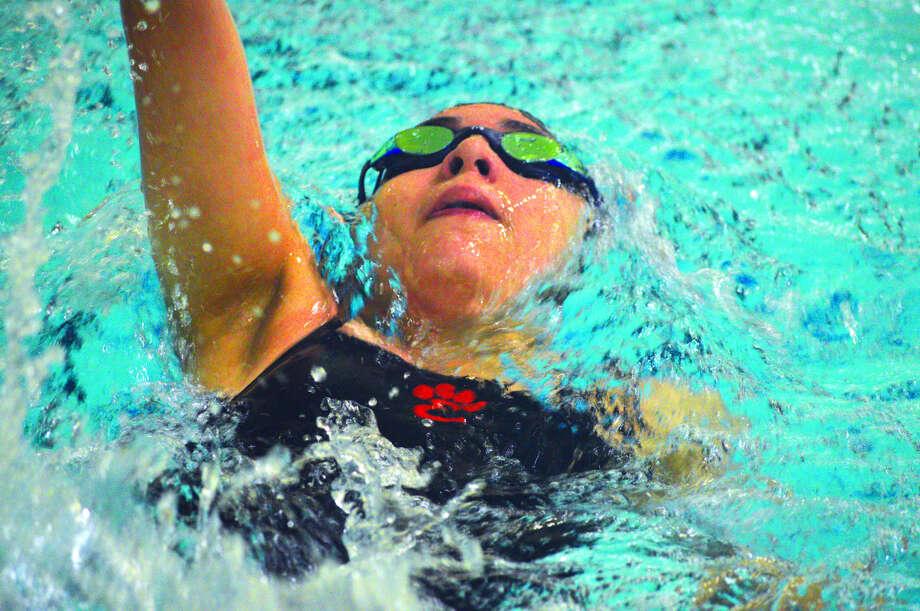 Edwardsville's Ximena Gonzalez swims in the 100-yard backstroke during Thursday's dual meet against Chatham Glenwood at Chuck Fruit Aquatic Center. Photo: Scott Marion