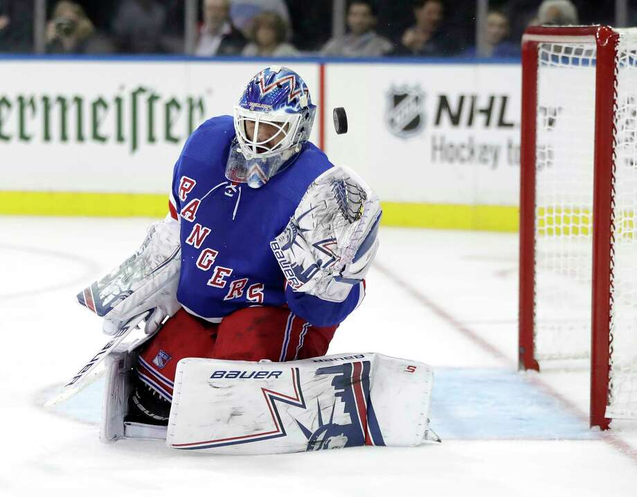 New York Rangers goaltender Henrik Lundqvist deflects a shot from the New York Islanders during the third period of an NHL hockey preseason game, Wednesday, Sept. 26, 2018, in New York. The Islanders won 4-3 in overtime. (AP Photo/Julio Cortez) Photo: Julio Cortez / Copyright 2018 The Associated Press. All rights reserved.