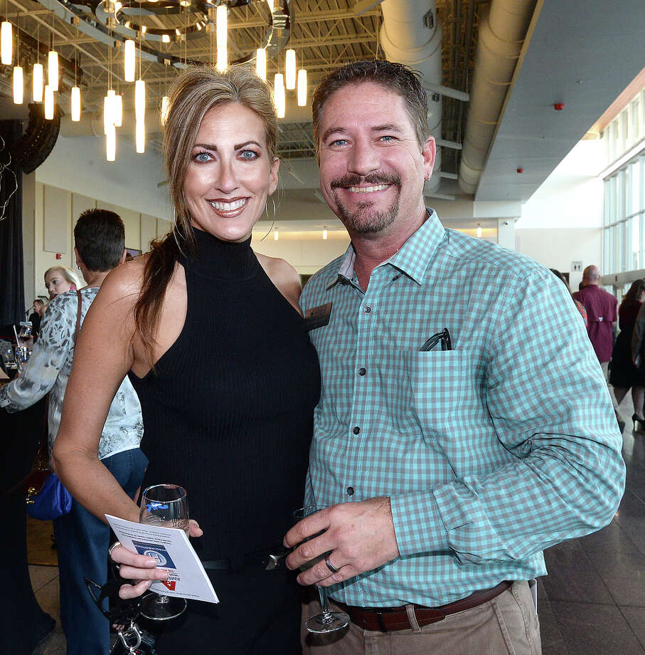 Michelle and Joey Armstrong were at the fourth annual Wine Down with Rotary, benefitting the Beaumont Rotary Foundation Thursday at the Event Centre. Attendees sampled six wines, paired with appetizers while enjoying jazz and a silent auction. Thursday, October 4, 2018 Kim Brent/The Enterprise Photo: Kim Brent/The Enterprise