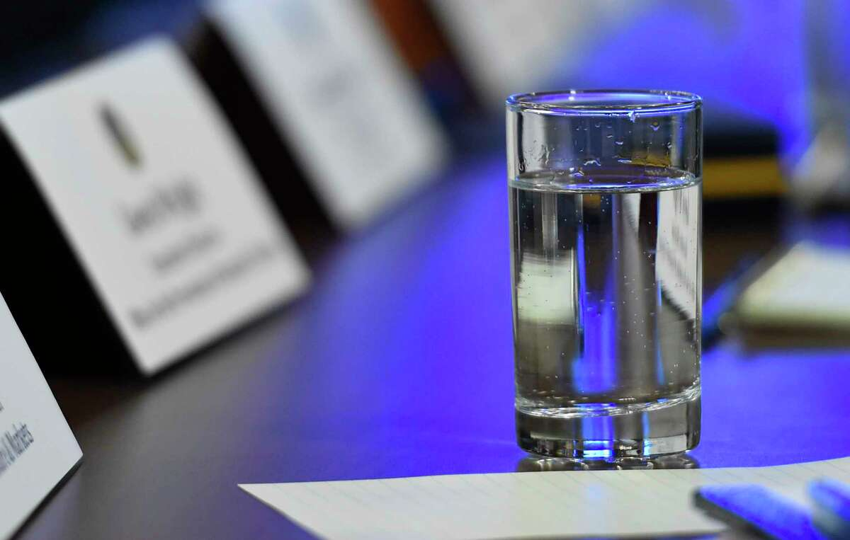 A glass of water sits on the desk during the Governor's cabinet meeting Dec. 17, 2014 in Albany, N.Y. (Skip Dickstein/Times Union)
