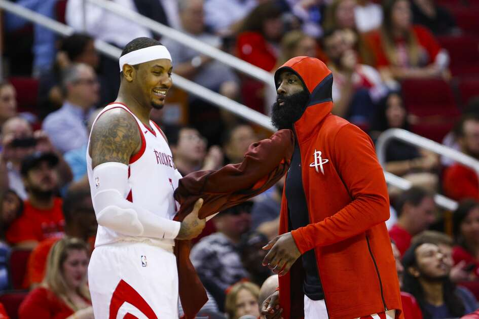 Houston Rockets forward Carmelo Anthony (7) and guard James Harden (13) talk before re-entering the game during the second half of a game between the Houston Rockets and the Indiana Pacers at Toyota Center, Thursday, Oct. 4, 2018 in Houston.