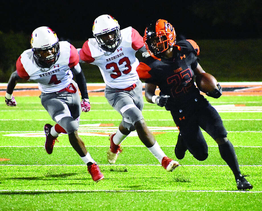 Edwardsville's Dionte Rodgers, right, picks up yardage during a 35-12 win over Alton on Sept. 21 at the District 7 Sports Complex. The Tigers play at 7:30 p.m. tonight at Belleville East. Photo: Matthew Kamp