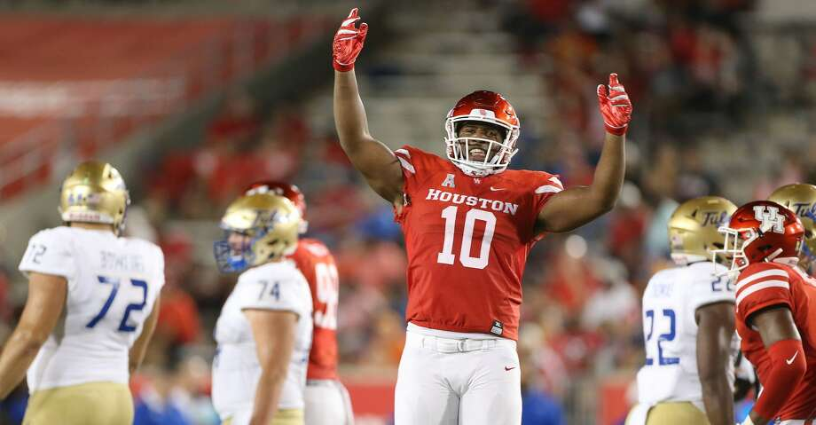 Houston Cougars defensive tackle Ed Oliver (10) tries to get the crowd into the game in the first half against Tulsa Golden Hurricane at TDECU Stadium on Thursday, Oct. 4, 2018 in Houston. Photo: Elizabeth Conley/Staff Photographer
