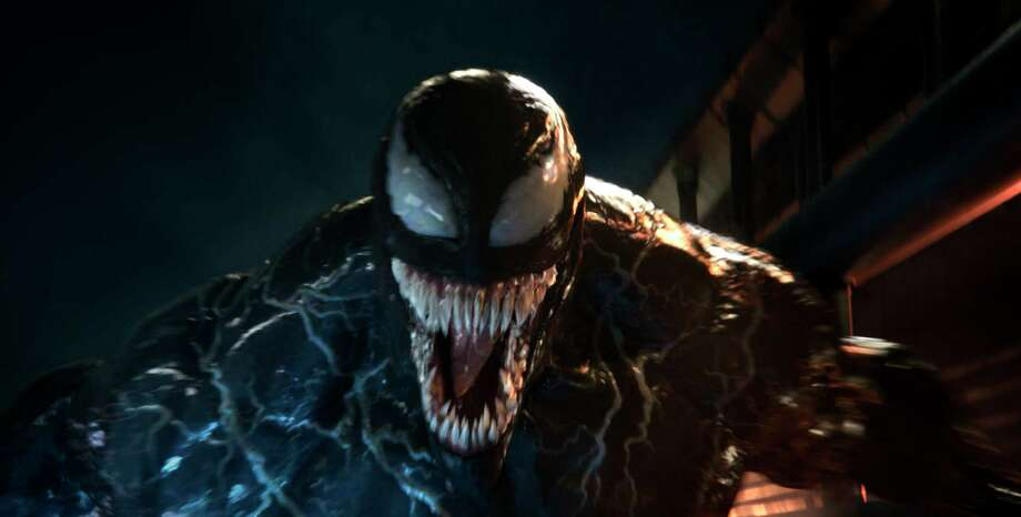 "This image released by Sony Pictures shows a scene from ""Venom."" (Sony Pictures via AP) Photo: Courtesy Sony Pictures / © 2018 CTMG, Inc. All Rights Reserved. **ALL IMAGES ARE PROPERTY OF SONY PICTURES ENTERTAINMENT INC. FOR PROMOTIONAL USE ONLY. S"