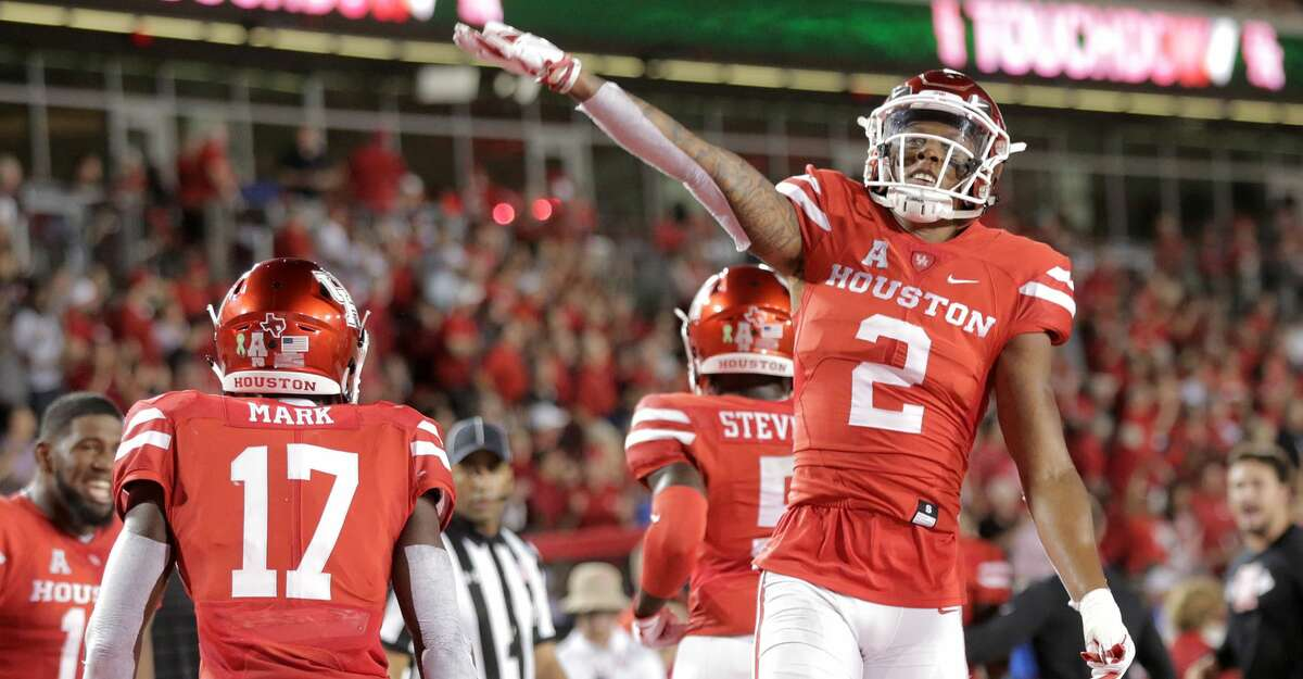 Houston Cougars wide receiver Keith Corbin (2) reacts to a touchdown in the first half against Tulsa Golden Hurricane at TDECU Stadium on Thursday, Oct. 4, 2018 in Houston.