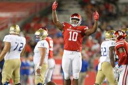 Houston Cougars defensive tackle Ed Oliver (10) tries to get the crowd into the game in the first half against Tulsa Golden Hurricane at TDECU Stadium on Thursday, Oct. 4, 2018 in Houston.