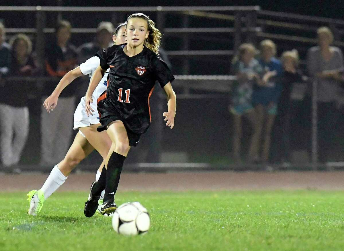 Bethlehem's Claire Hutton (11) moves the ball past Shaker's Hannah Guidi (12) during a Section II High School girls soccer game Thursday, Oct. 4, 2018, in Delmar, N.Y. (Hans Pennink / Special to the Times Union)