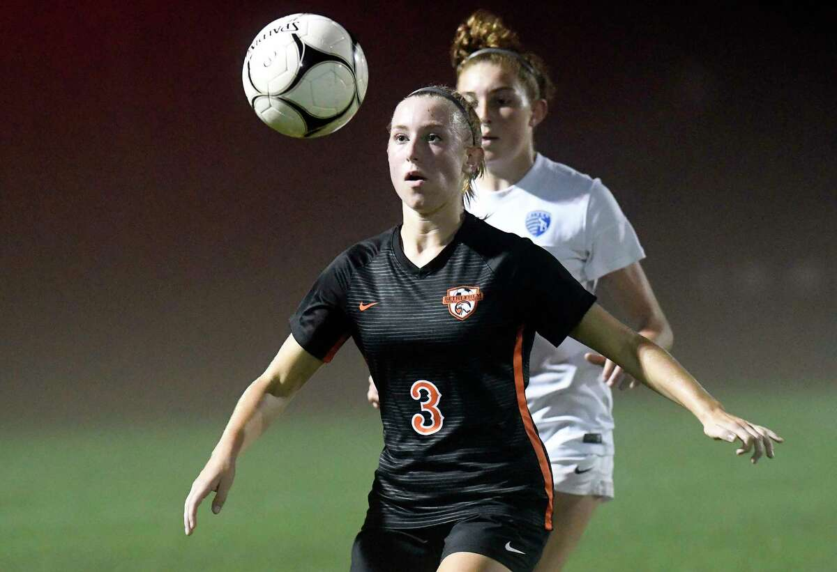 Bethlehem's Katie Hotaling (3) moves the ball past Shaker's Oliva Martusello(19) during a Section II High School girls soccer game Thursday, Oct. 4, 2018, in Delmar, N.Y. (Hans Pennink / Special to the Times Union)