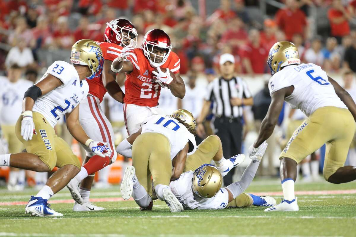 Houston Cougars running back Patrick Carr (21) gets stopped in the second half against Tulsa Golden Hurricane at TDECU Stadium on Thursday, Oct. 4, 2018 in Houston. Houston Cougars won the game 41-26.