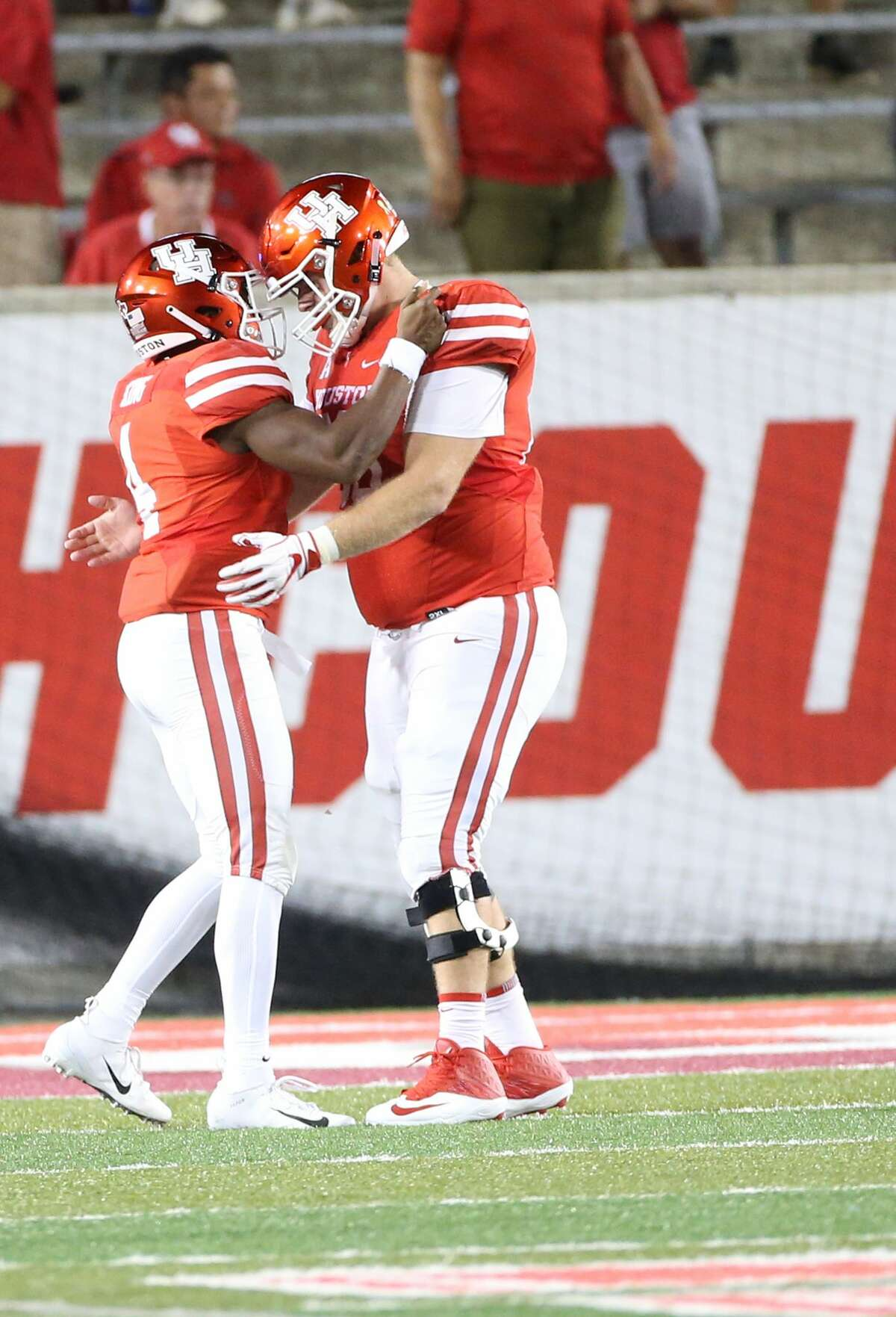 Houston Cougars quarterback D'Eriq King (4) is congratulated by Houston Cougars offensive lineman Will Noble (69) after King ran for a touchdown in the second half against Tulsa Golden Hurricane at TDECU Stadium on Thursday, Oct. 4, 2018 in Houston. Houston Cougars won the game 41-26.