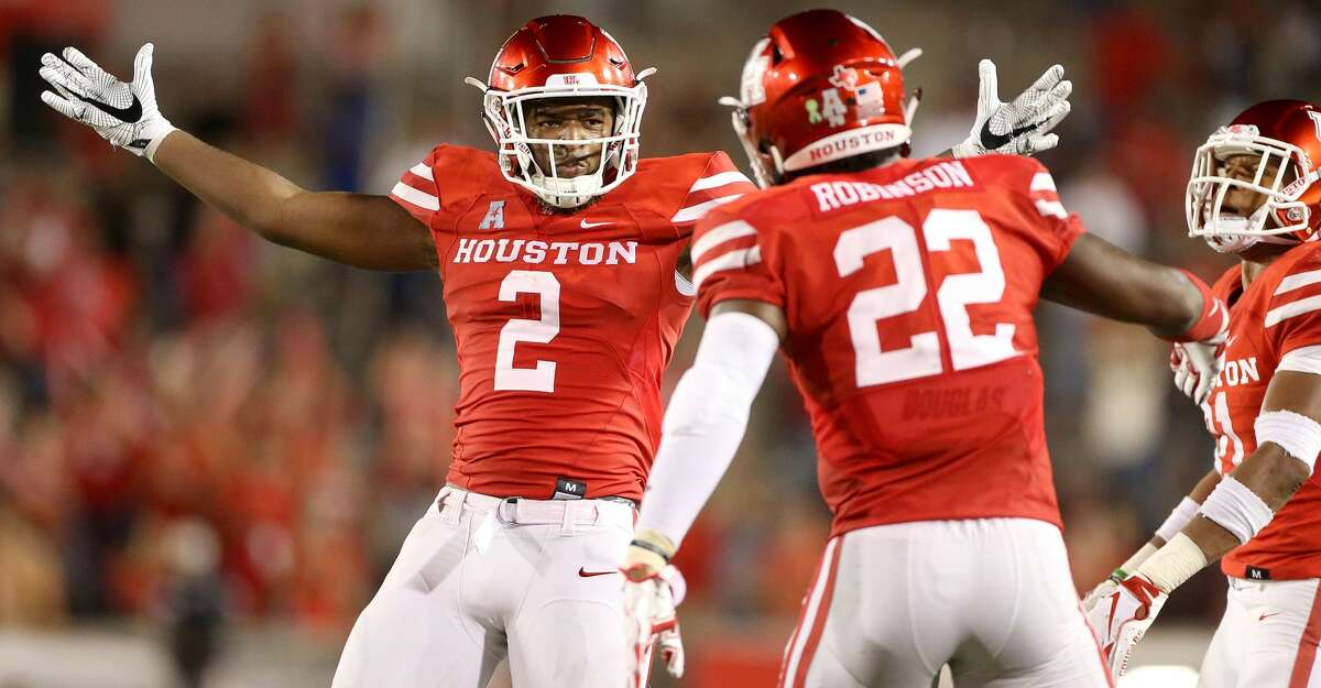 Houston Cougars defensive back Deontay Anderson (2) celebrates an intercepted pass in the second half against Tulsa Golden Hurricane at TDECU Stadium on Thursday, Oct. 4, 2018 in Houston. Houston Cougars won the game 41-26.
