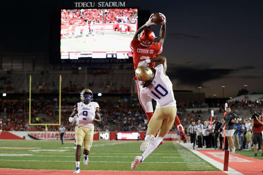 HOUSTON, TX - OCTOBER 04: Keith Corbin #2 of the Houston Cougars catches a pass for a touchdown defended by Manny Bunch #10 of the Tulsa Golden Hurricane in the first quarter at TDECU Stadium on October 4, 2018 in Houston, Texas. (Photo by Tim Warner/Getty Images) Photo: Getty Images