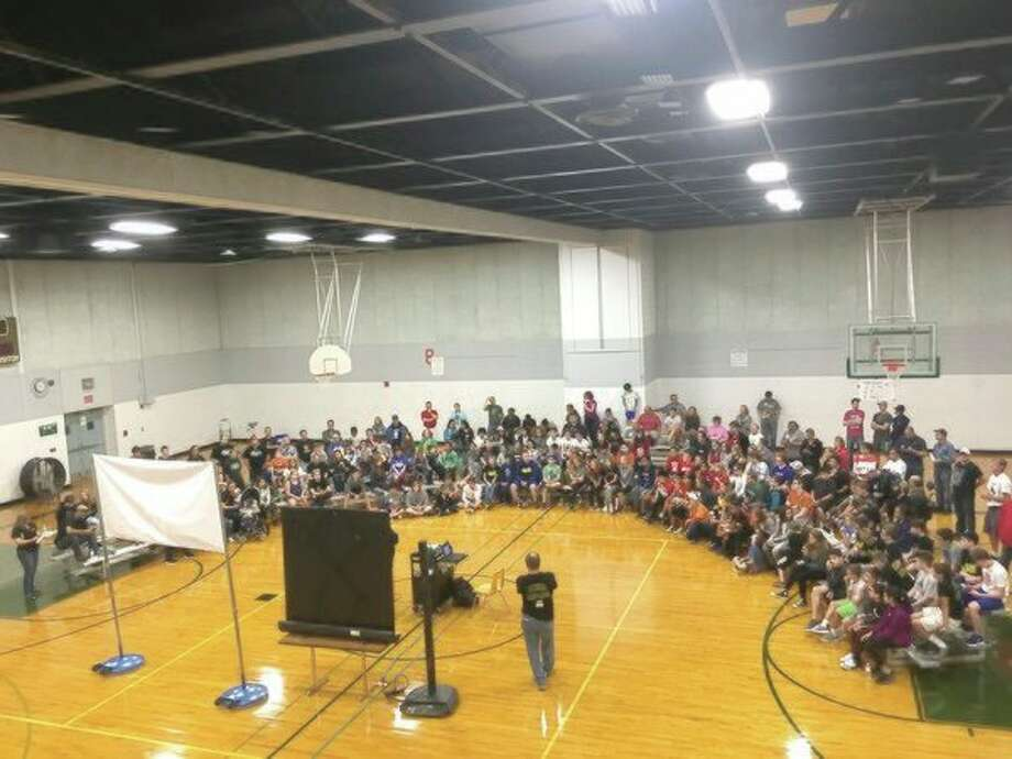About 250 student members of local area FIRST Tech Challenge Robotics Team anxiously await the announcement of the Rover Ruckus Challenge. (Submitted photo)