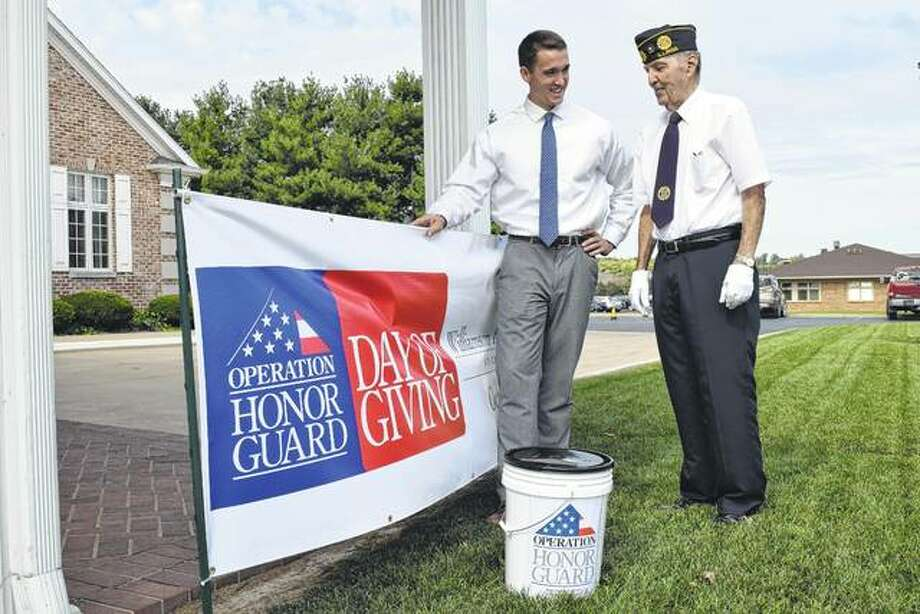 Nathan Freeman of Williamson Funeral Home (left) talks Thursday with Ralph Johnson of rural Pisgah, a member of the Combined Veterans Ceremonial Team, during Operation Honor Guard's Day of Giving collection drive outside Williamson Funeral Home in Jacksonville. Donations will help the local honor guard cover expenses. Photo: Greg Olson | Journal-Courier