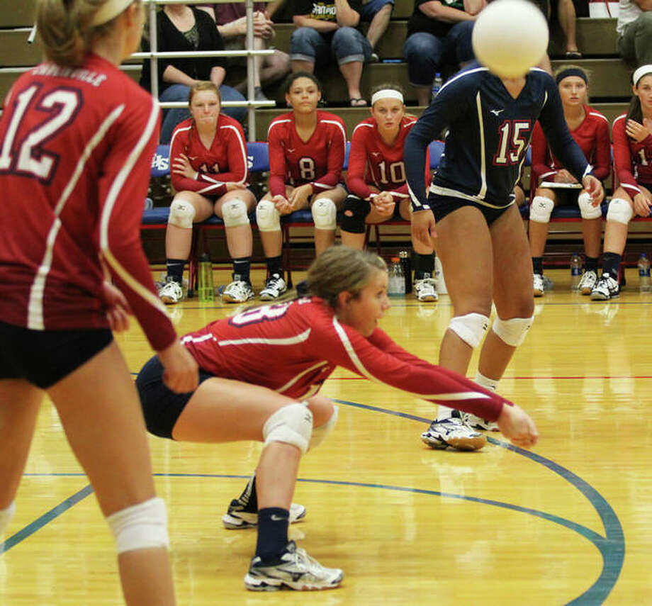 Carlinville's Gracie Reels passes out of serve receive between teammates Jordyn Houseman (right) and Adriann Welte (left) in a match earlier this season in Carlinville. The Cavs were on the road for a SCC match Thursday and lost a two-set decision at Staunton. Photo: Greg Shashack / The Telegraph