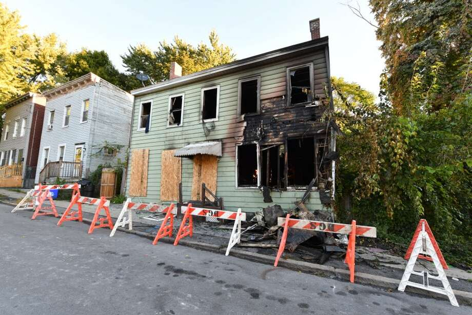 Fire gutted a home on Third Avenue in Albany on Thursday, Oct. 4, 2018.  City Buildings and Regulatory Compliance Director Rick LaJoy said the structure cannot be saved. Photo: Skip Dickstein/Times Union