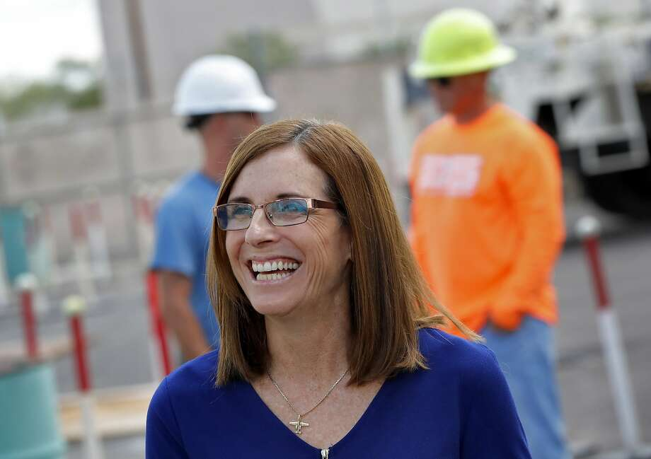 U.S. Rep. Martha McSally, R-Ariz., who is running against U.S. Rep. Kyrsten Sinema, D-Ariz., for the senate seat being vacated by retiring U.S. Sen. Jeff Flake, R-Ariz., talks to tours at a crane manufacturing and training facility, Wednesday, Oct. 3, 2018, in Phoenix. Arizona's Senate race pits Sinema, a careful politician running as a centrist in a Republican-leaning state, against McSally, a onetime Trump critic turned fan. (AP Photo/Matt York) Photo: Matt York / Associated Press