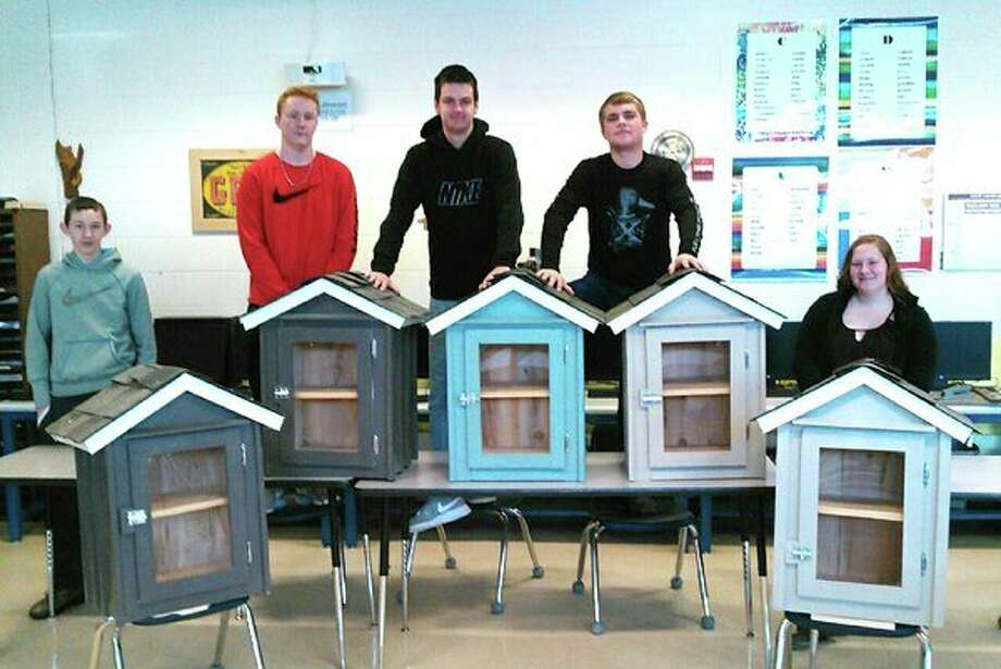 North Huron shop class students Carl Jahn, Codey Kozfkay, Kristian Krull, Austin Majeski and Courtney Stewart designed and built the little libraries. (Submitted Photo)