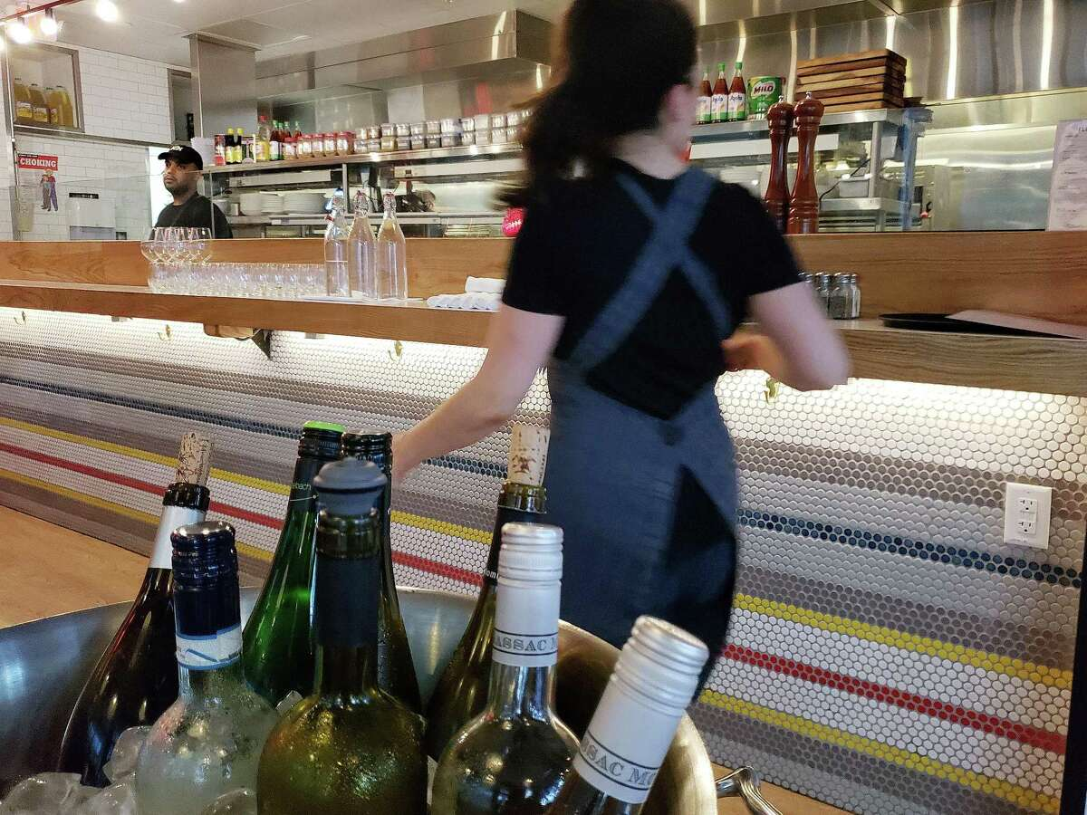 In the fresh and classy modern space with bands of colorful tiles the chefs put on a show in the open kitchen at Flinders Lane in Stamford.