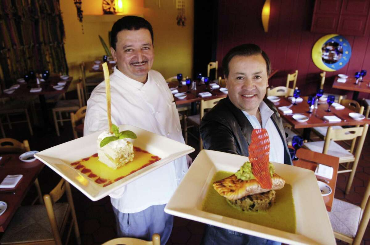 Stamford_041007_ (L to R) Chef Asdruval Alfaro (cq) and Owner Jaime Guerrero of Las Brasitas Restaurant with two of their specialities, Tres Leches cake and pan seared Salmon.. Kathleen O'Rourke/Staff photo Staff Photo Kathleen O'Rourke