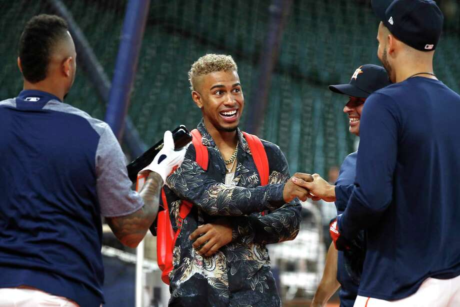 Cleveland Indians shortstop Francisco Lindor laughs with Houston Astros shortstop Carlos Correa  before the start of the ALDS Game 1 at Minute Maid Park, October 5, 2018, in Houston. Photo: Karen Warren, Staff Photographer / © 2018 Houston Chronicle