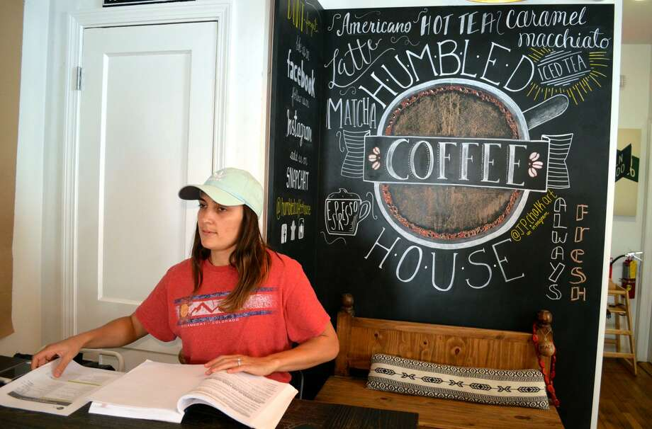 Dori Lund of Stamford spends some time at the Humbled recently. Humbled Coffeehouse in Springdale was voted a best new business by readers in August. Photo: Jarret Liotta / For Hearst Connecticut Media / Stamford Advocate freelance