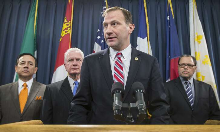 Senator Charles Schwertner, center, speaks with members of the Senate Health and Human Services committee as they announce legislation at the Texas State Capitol on Wednesday, Feb. 11, 2015 in Austin. The University of Texas is investigating Schwertner after allegedly sending lewd text messages to a graduate student. (AP Photo/Austin American-Statesman, Ricardo B. Brazziell)
