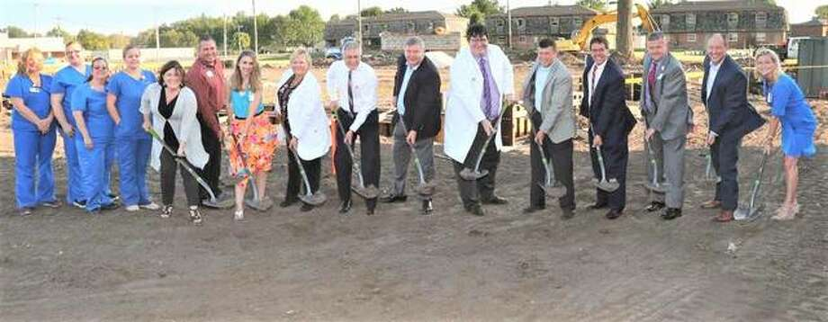 Alton Memorial Hospital and BJC Medical Group leaders, plus staff at Family Physicians of Bethalto and village leaders, including Bethalto Mayor Alan Winslow, gathered Wednesday for an official groundbreaking of the new medical office building to soon be constructed. Plans call for the new building to be open for business in the spring of 2019. The building will replace the Family Physicians of Bethalto office and will be located on the south side of Route 140, just east of its current location. At nearly 9,000 square feet, the new structure will be four times the size of the current office. It will be able to accommodate five providers, the current space has room for only two, and will have a Christian Reference lab on-site. Photo: Courtesy Of Alton Memorial Hospital