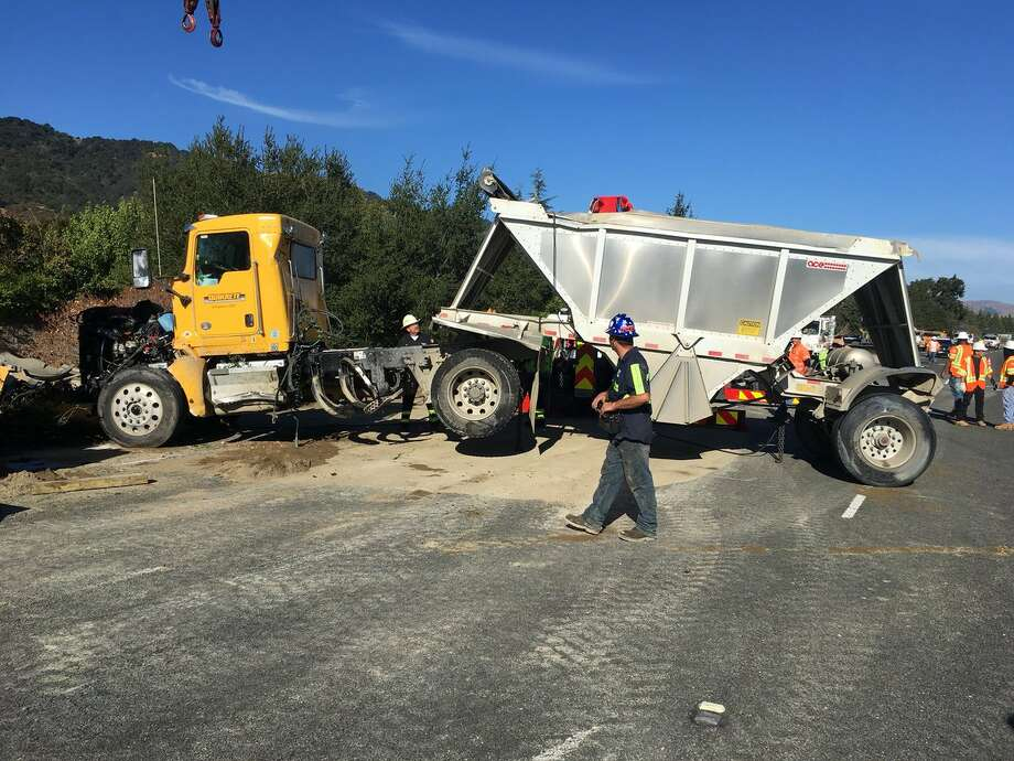 A big rig that overturned and spilled 27 tons of dirt onto the roadway early  Friday on Interstate 680 in Pleasanton is lifted up. The accident resulting in major traffic  delays. Photo: CHP Dublin